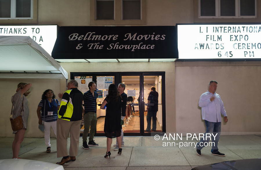 Bellmore, New York, USA. 19th July 2017. Filmmakers, including Director BRAD KUHLMAN (at rear center of doors), and film aficionados chat outside the Bellmore Movies theater after the final night films are screened at Long Island International Film Expo LIIFE 2017.