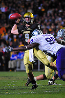 18 October 08: Colorado quarterback Tyler Hansen passes while against Kansas State while under pressure from defensive end Brandon Harold (99). The Colorado Buffaloes defeated the Kansas State Wildcats 14-13 at Folsom Field in Boulder, Colorado.