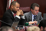 Nevada Senate Minority Leader Aaron Ford, D-Las Vegas, works in committee at the Legislative Building in Carson City, Nev., on Thursday, March 19, 2015. <br /> Photo by Cathleen Allison