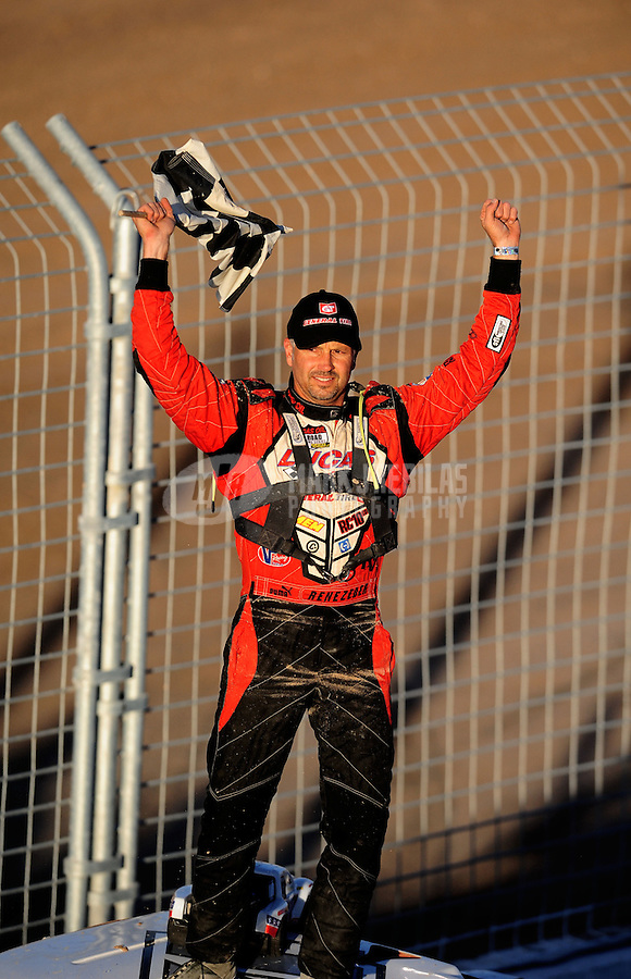 Nov. 6, 2010; Las Vegas, NV USA; LOORRS pro two unlimited driver Carl Renezeder celebrates his victory during round 13 at the Las Vegas Motor Speedway short course. Mandatory Credit: Mark J. Rebilas-