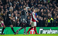 Jack Wilshere of Arsenal is lead off the pitch following a ankle injury during the Carabao Cup semi final 1st leg match between Chelsea and Arsenal at Stamford Bridge, London, England on 10 January 2018. Photo by Andy Rowland.