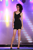 A model wearing a short black dress by Silvian Heach at the Moda sotto le stelle fashion show held in little Italy in Montreal