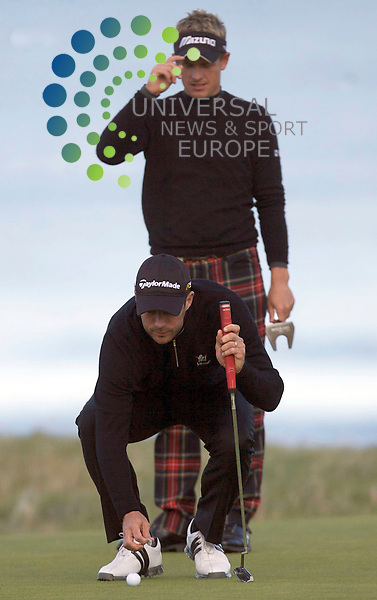 The Alfred Dunhill Golf Championship 2009 at The Old Course, St Andrews, Kingsbarns and Carnoustie.. . Luke Donald and Jamie Redknapp   during the Gale-Force Delayed Third  Round of the Alfred Dunhill Golf Championship...Picture by Mark Davison/ Universal News & Sport