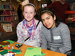 Caoimhe Weldon and Danielle Aravena pictured at the St. Patrick's Art workshop held in the library. Photo: Colin Bell/pressphotos.ie