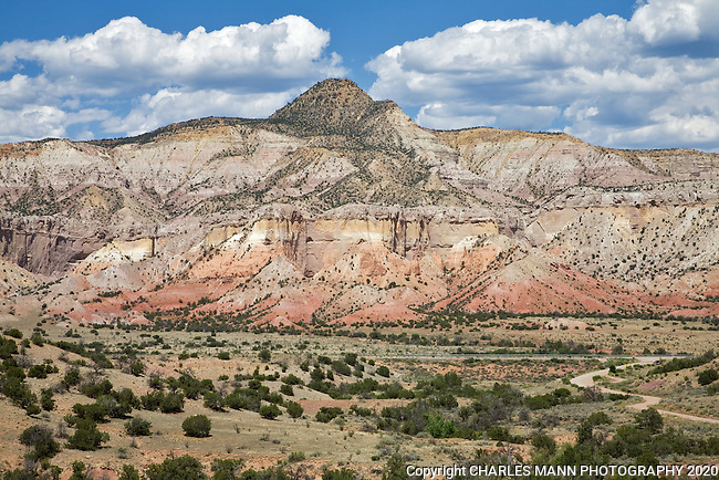 Colorful red, yellow and beige sandstone of the cliffs surround Ghost Ranch, a retreat center near Abiquiu, New Mexico