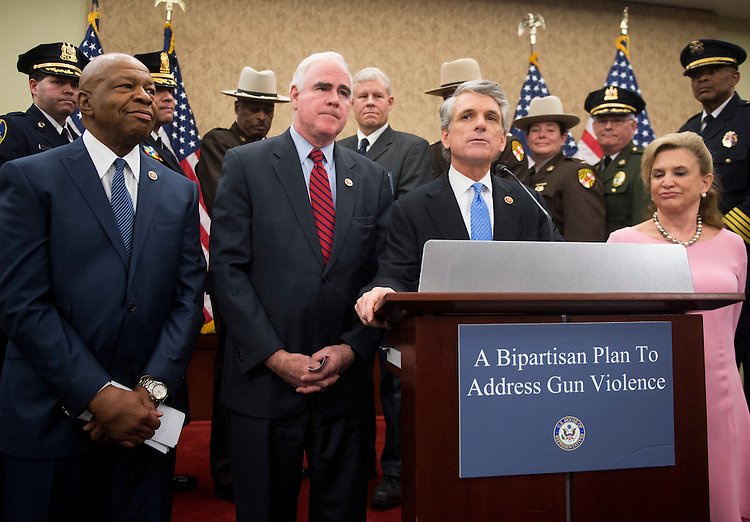 "UNITED STATES - FEBRUARY 5: From left, Rep. Elijah Cummings, D-Md., Rep. Pat Meehan, R-Pa., Rep. Scott Rigell, R-Va., and Rep. Carolyn Maloney, D-N.Y., hold their news conference in the Capitol Visitor Center to introduce the ""Gun Trafficking Prevention Act of 2013,"" on Tuesday, Feb. 5, 2013. (Photo By Bill Clark/CQ Roll Call)"