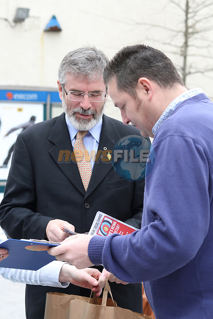 Gerry Adams with Cllr Matthew Coogan at the Launch of the Campaign against the Universal Social Charge in Drogheda...(Photo credit should read Jenny Matthews www.newsfile.ie)....This Picture has been sent you under the conditions enclosed by:.Newsfile Ltd..The Studio,.Millmount Abbey,.Drogheda,.Co Meath..Ireland..Tel: +353(0)41-9871240.Fax: +353(0)41-9871260.GSM: +353(0)86-2500958.email: pictures@newsfile.ie.www.newsfile.ie.