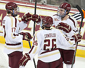 Destry Straight (BC - 17), Austin Cangelosi (BC - 26) and Ryan Fitzgerald (BC - 19) celebrate Straight's goal which made it 6-1 BC early in the third period. - The Boston College Eagles defeated the visiting University of New Hampshire Wildcats 6-2 on Friday, December 6, 2013, at Kelley Rink in Conte Forum in Chestnut Hill, Massachusetts.