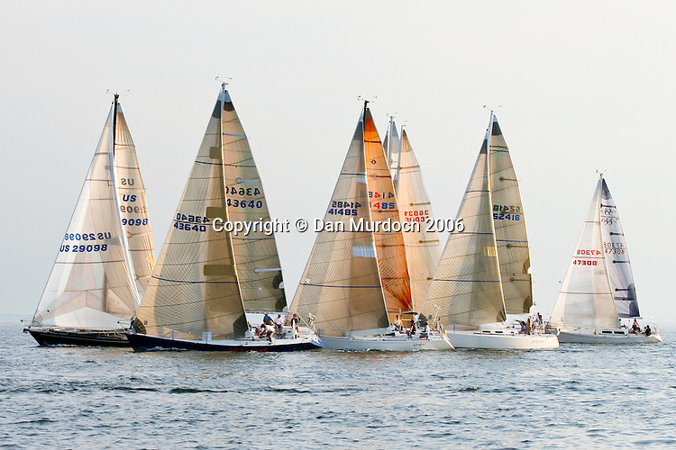 Sailboats racing at dusk