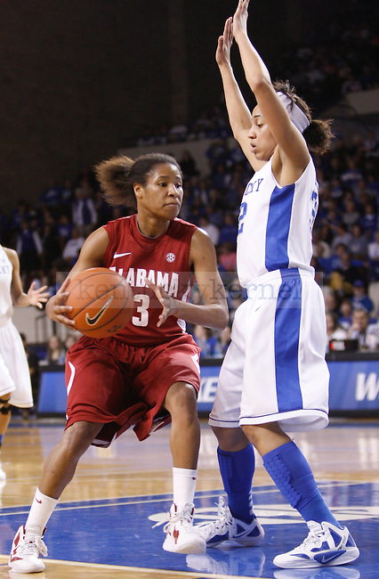 UK guard Kastine Evans guards Alabama's Jasmine Robinson during the first half of the UK Women's basketball game against Alabama on 1/29/12 at Memorial Coliseum in Lexington, Ky. Photo by Quianna Lige | Staff