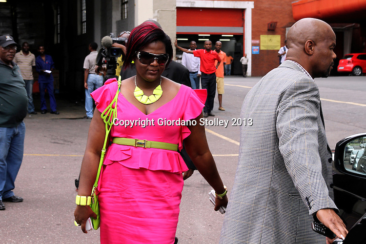 """DURBAN - 8 February 2013 - Durban business woman Mabongi Flora-Junior """"Shauwn"""" Mpisane who is accused of submitting false documents to obtain Construction Industry Development Board gradings, which were then used to obtain public works department tenders worth R140 million, leaves the Durban Commercial Crimes Court after being granted R100,000 bail. Picture: Giordano Stolley/Allied Picture Press/APP"""