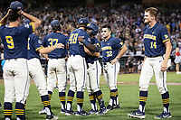 Michigan Wolverines second baseman Ako Thomas (4) hugs teammate Jack Weisenburger (48) after losing to the Vanderbilt Commodores during Game 3 of the NCAA College World Series Finals on June 26, 2019 at TD Ameritrade Park in Omaha, Nebraska. Vanderbilt defeated Michigan 8-2 to win the National Championship. (Andrew Woolley/Four Seam Images)