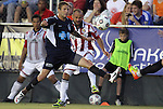05 June 2012: Chivas USA's Laurent Courtois (FRA) (behind) sends the ball past Carolina's Brian Shriver (in blue). The Carolina RailHawks (NASL) lost 1-2 to Club Deportivo Chivas USA (MLS) at WakeMed Soccer Stadium in Cary, NC in a 2012 Lamar Hunt U.S. Open Cup fourth round game.