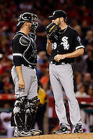Catcher Tyler Flowers #21 of the Chicago White Sox talks with his teammate pitcher Chris Sale #49 during a game against the Los Angeles Angels at Angel Stadium on May 17, 2013 in Anaheim, California. (Larry Goren/Four Seam Images)