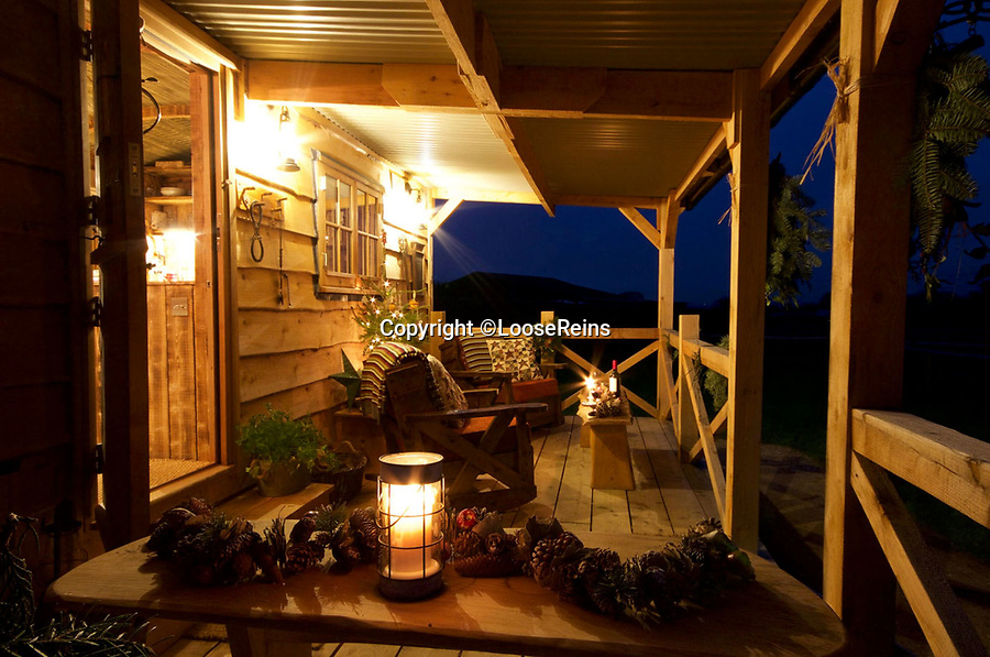 BNPS.co.uk (01202 558833)Pic: LooseReins/BNPS<br /> <br /> At the end of a days trekking you can kick back your heels on the verandah.<br /> <br /> Fancy a home on the range - Release your inner cowboy with this million pound ranch...for sale in the heart of Dorset.<br /> <br /> Perfect for City Slickers the thriving western themed business comes with 6 ranch style lodges and 10 'Quarter' horses - the preferred steed for any self respecting cowboy.<br /> <br /> Owner's Mark and Michelle Gibbs claim that once you turn into the Loose Reins ranch near Blandford in Dorset you could be in the wilds of Montana rather than rural Dorset.