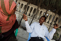The Horn Afrique  RADIO reporter ( on left) interviews Abdi Nure Siad, war lord back in his area  in Mogadishu on tuesday January 02 2007..Only a few days after the fall of the United Islamic Courts in Mogadishu, Ethiopian and Transitional Federal Government troops are patrolling the city and securing strategic locations..The people in Mogadishu appear confused and doubtful on t