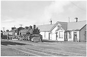 D&amp;RGW #498 with string of tank cars standing at Chama depot.<br /> D&amp;RGW  Chama, NM  Taken by Richardson, Robert W. - 2/26/1954
