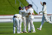 Wellington's Malcolm Nofal is congratulated by Firebirds teammates for taking the final wicket during day four of the Plunket Shield cricket match between the Wellington Firebirds and Canterbury at Basin Reserve in Wellington, New Zealand on Friday, 1 November 2019. Photo: Dave Lintott / lintottphoto.co.nz