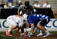Brian McDermott (26) of Virginia lines up for the face off with Terrence Molinari (30) of Duke during the ACC men's lacrosse tournament semifinals in College Park, MD.  Virginia defeated Duke, 16-12.