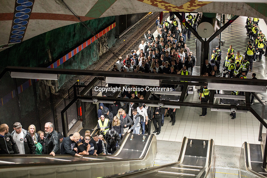 August 25, 2018: Supporters of the neo Nazi Nordic Resistance Movement NRM (Nordiska motståndsrörelsen) are escorted by police forces out of a metro station after a demonstration at the Kungsholmstorg square in Stockholm, Sweden. An estimate of 200 supporters of the neo-Nazi organisation held a six-hour rally guarded by a strong police deployment.