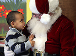 Ernesto Delallana, 3, talks to Santa during Storytime at the Carson City Library on Thursday, Dec. 13, 2012. .Photo by Cathleen Allison