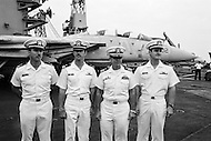 """24 Aug 1981, Naples, Italy --- Lieutenants, and radar specialists, James Anderson (L) and David Venlet (R), with pilots Lawrence Muczynski (second, L) and, commander, Henry Kleeman aboard the American supercarrier and warship USS """"Nimitz"""", during the Gulf of Sidra incident. --- Image by © JP Laffont"""