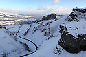 14/01/13:   ..After heavy snowfall earlier today, walkers enjoy the view over Winnats Pass towards Castleton, in the Derbyshire Peak District...All Rights Reserved - F Stop Press.  www.fstoppress.com. Tel: +44 (0)1335 300098.