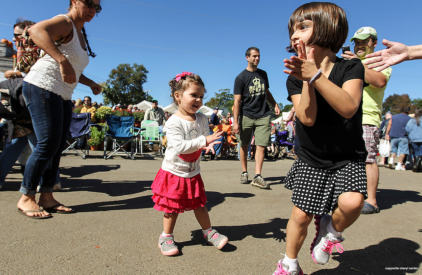 Dancing to live blue grass music, family members from left, mom, Nicole Palermo Cristaldi of Hull, MA., with daughters Ava, 2, center, and Sophia, 6, right, during the Applecrest Farm Orchards 100th year celebration in Hampton Falls, N.H., Sunday, Sept. 29, 2013.  (Portsmouth Herald Photo Cheryl Senter)