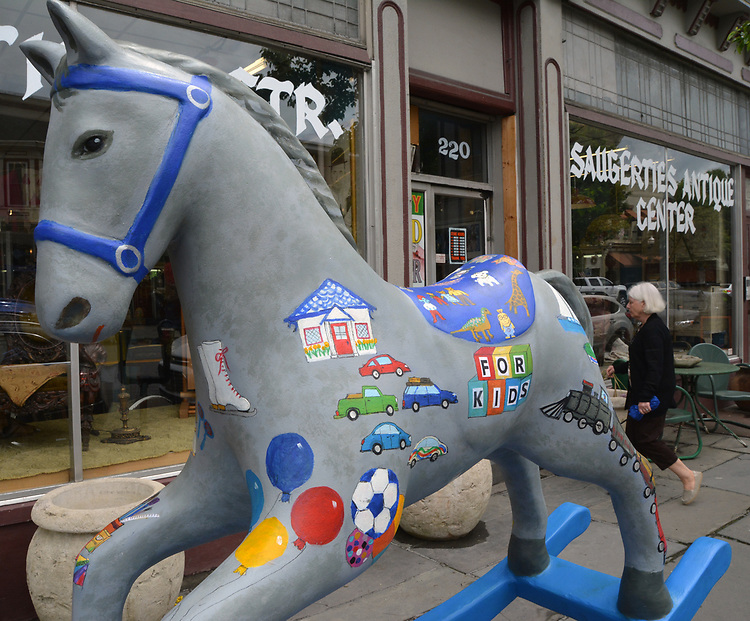 "A view of, ""Toys R Rockin"" by artist, Mary Boscher, one of the painted Rocking Horses on display around Saugerties, NY as part of the Chamber of Commerce sponsored Art in the Village Project titled ""Rockin' Around Saugerties."" This photo taken on Friday, May 26, 2017. Photo by Jim Peppler. Copyright/Jim Peppler-2017."
