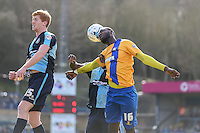 Mani Dieseruvwe of Mansfield Town (right) wins the aerial battle during the Sky Bet League 2 match between Wycombe Wanderers and Mansfield Town at Adams Park, High Wycombe, England on 25 March 2016. Photo by David Horn.