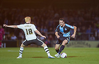 Stephen McGinn of Wycombe Wanderers goes round Ben Pringle of Fulham during the Capital One Cup match between Wycombe Wanderers and Fulham at Adams Park, High Wycombe, England on 11 August 2015. Photo by Andy Rowland.