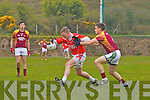 Kieran Quirke of Duagh tries to stop the advance of Kieran Hurley of St Pat's Blennerville last Sunday in Duagh.