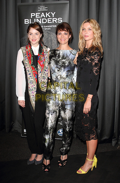 Sophie Rundle, Helen McCrory and Annabelle Wallis<br /> Gala Screening of 'Peaky Blinders' at the BFI South Bank, London, England.<br /> 21st August 2013<br /> full length black white blue pattern sleeveless jumpsuit red floral print jacket trousers lace dress ankle strap yellow shoes<br /> CAP/ROS<br /> &copy;Steve Ross/Capital Pictures