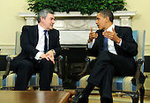 Washington, DC - March 3, 2009 -- United States President Barack Obama (R) talks to Prime Minister Gordon Brown of Great Britain  during a media availability following a meeting in the Oval Office at the White House in Washington on Tuesday, March 3, 2009..Credit: Kevin Dietsch / Pool via CNP
