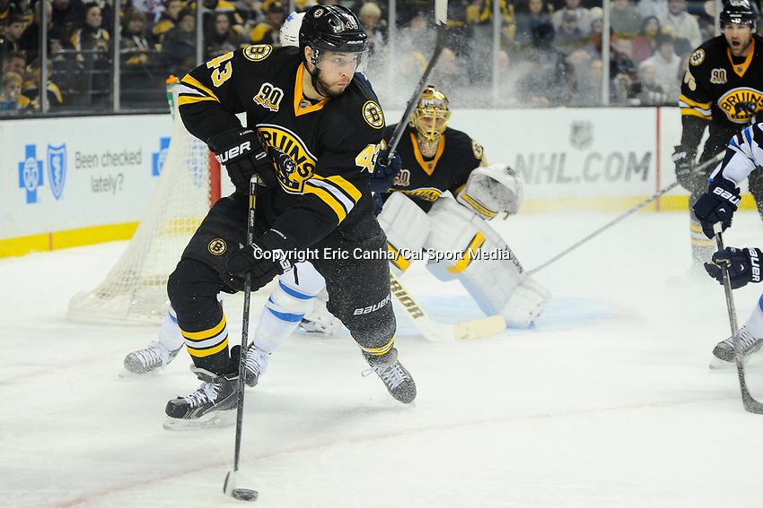 January 2, 2014 - Boston, Massachusetts, U.S. - Boston Bruins defenseman Matt Bartkowski (43) works to clear the puck during the NHL game between Winnipeg Jets and the Boston Bruins held at TD Garden in Boston Massachusetts.  Boston defeated Winnipeg 4-1 in regulation. Eric Canha/CSM