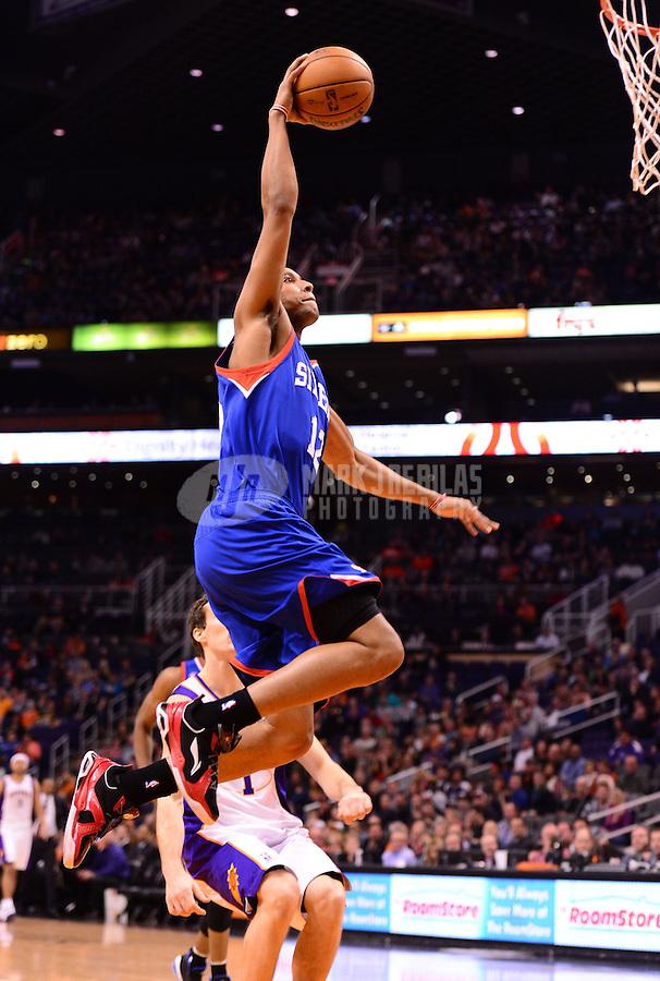 Jan. 2, 2013; Phoenix, AZ, USA: Philadelphia 76ers forward Evan Turner (12) dunks the ball in the first half against the Phoenix Suns at the US Airways Center. Mandatory Credit: Mark J. Rebilas-USA TODAY Sports