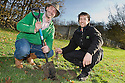 Colin Reid, Link Housing Association, and Ben Williams, The Helix,  join pupils from Braes High School in planting trees at Little Kerse..