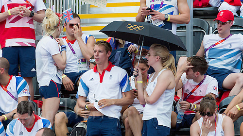 09 AUG 2012 - LONDON, GBR - David Carry (centre left), the fiance of competitor Keri-Anne Payne watches the London 2012 Olympic Games women's 10km Marathon Swimming in Hyde Park, London, Great Britain with Rebecca Adlington (centre right) .(PHOTO (C) 2012 NIGEL FARROW)