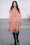 """Model Karmay walks runway in an ultra suede drop waist dress with applique in rose quartz, from the Vivienne Tam Fall Winter 2016 """"Cultural Dreamland The New Silk Road"""" collection, presented at NYFW: The Shows Fall 2016, during New York Fashion Week Fall 2016."""