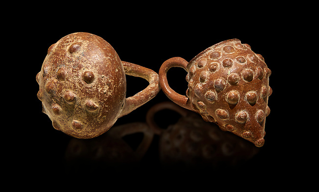Bronze Age Anatolian terra cotta basket with handle & a beaker shaped as a bunch of grapes - 19th to 17th century BC - Kültepe Kanesh - Museum of Anatolian Civilisations, Ankara, Turkey.  Against a black background.