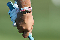 "Lexi Thomspn practice her swing while wearing one bracelet states ""Greatness,"" second bracelet a breast cancer awareness, and the last one which was pink at the 5th Annual Notah Begay III Foundation Challenge at Atunyote Golf Club in Vernon, New York on August 29, 2012"