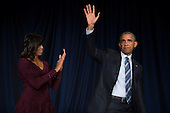 United States President Barack Obama receives a standing ovation from first lady Michelle Obama, left, during the National Prayer Breakfast in Washington, DC, USA, 03 February 2016. For 63 years the National Prayer Breakfast has given presidents the  opportunity to gather with members of congress and evangelical Christians to pray and talk about the role of prayer in their own lives.<br /> Credit: Shawn Thew / Pool via CNP