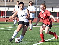 RICK PECK/SPECIAL TO MCDONALD COUNTY PRESS  McDonald County's Nautica Gutierrez lines up a shot during the Lady Mustangs' 1-0 loss to Carl Junction in the Missouri Class 3 District 11 Girls' Soccer Tournament on May 13 at MCHS.