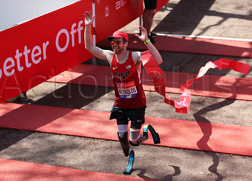 22nd April 2018, London, England; The 2018 Virgin London Marathon; Brian Reynolds of USA crossing the finish line in the T62-64 Men race
