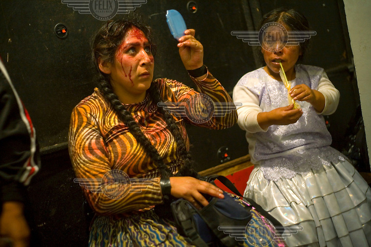 29 year old wrestler Martha La Altena (fighting name), Yenny Wilma Maraz (real name) checks her face after a fight at the Multifuncional building. Esperanza is a Cholita, a wrestler of native Aymara descent. When Cholitas fight they wear traditional costume. The blood on her face is believed to be fake, but the fighters insist that it is real. Yenny fights with the lucha libre (free wrestling) group Los Titanes del Ring. ....