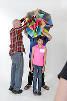 OrigamiUSA 2016 Convention at St. John's University, Queens, New York, USA. Oversized 9' x 9' paper folding event. First timers. Left to right: Kika Salgo (front), NY, Ben Fritzson (middle under model), PA, Doug Caine (left), NY.