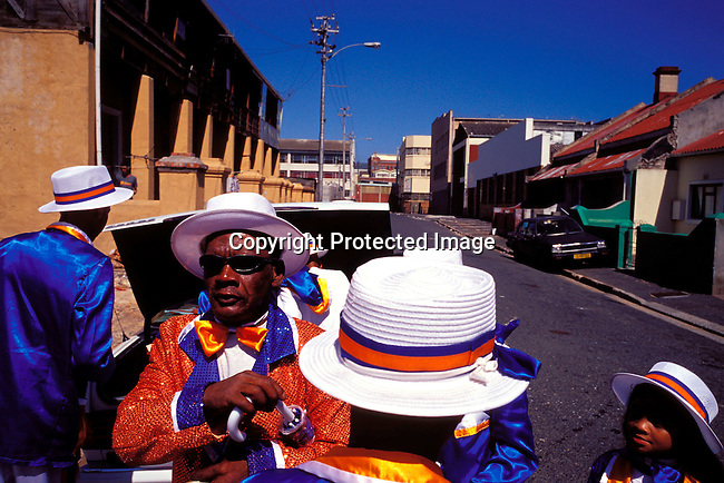 """dippcoo00050 .People. Coons.  Cape Minstrels CAPE TOWN, SOUTH AFRICA - JANUARY 2: Unidentified members of the Fabulous Woodstock starlights is preparing for the yearly """"Coon Carnival"""" on January 2, 2003 in Woodstock outside Cape Town, South Africa. The carnival performers are primarily mixed-race, or colored people and the carnival began in the early 19th century when slave bands played friendly competition during the annual Jan. 2 slave holiday. The parade has become a popular tourist attraction and the colorful floats are competing at a local stadium for days for the best costumes and performances..©Per-Anders Pettersson/ iAfrika Photos.."""