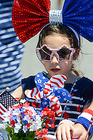 A young girls wears independence themed garb during the Independence Parade Saturday July 2, 2016 on Beach Avenue in Cape May, New Jersey. Photo by William Thomas Cain/Cain Images