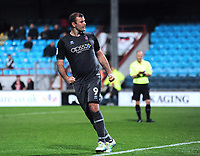 Lincoln City's Matt Rhead celebrates scoring his penalty in the penalty shoot out<br /> <br /> Photographer Andrew Vaughan/CameraSport<br /> <br /> The EFL Checkatrade Trophy Northern Group H - Scunthorpe United v Lincoln City - Tuesday 9th October 2018 - Glanford Park - Scunthorpe<br />  <br /> World Copyright &copy; 2018 CameraSport. All rights reserved. 43 Linden Ave. Countesthorpe. Leicester. England. LE8 5PG - Tel: +44 (0) 116 277 4147 - admin@camerasport.com - www.camerasport.com