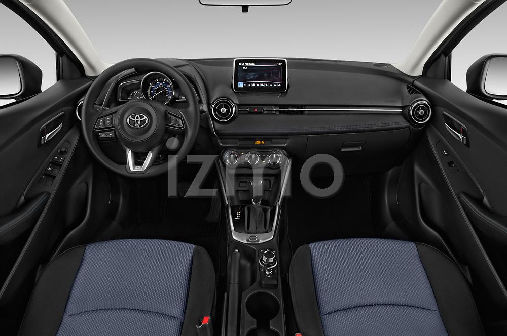 Stock photo of straight dashboard view of a 2018 Toyota Yaris LE 4 Door Sedan
